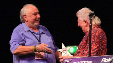 Some fans have called for Bluesfest founder Peter Noble, pictured with legendary bluesman John Mayall, to step down.