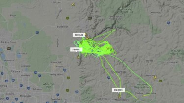 The water bombers covering the fire zone on Wednesday afternoon.