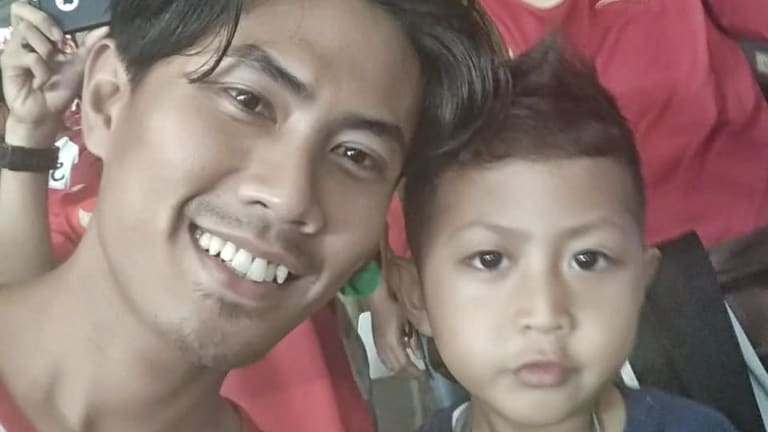 The last photo Wahyu Adilla, with son Xherdan Fachridzi, 4, sent his pregnant wife. They had flown to Jakarta to watch a soccer match.