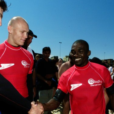 Grant Hackett and Michael Klim meet  Moussambani at Bondi.