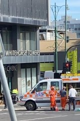 SES and police secure the area below the Whitehorse Towers on December 30.