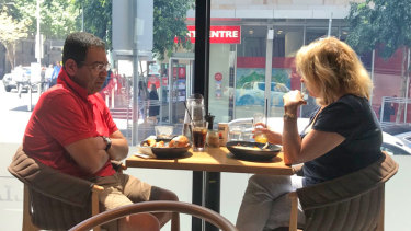 Surveillance photo of councillor Sam Aziz meeting ex-MP Lorraine Wreford in a city cafe.