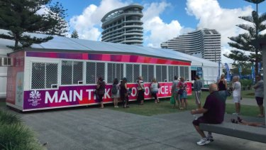 People buying Commonwealth Games tickets at Broadbeach on the Gold Coast on Tuesday.