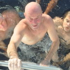 Brett Archibald being pulled from the water after surviving nearly 29 hours in Indonesian waters.