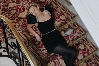 Slumming it: Jaimee Belle Kennedy takes time out on the stairwell at Paris' swanky Plaza Athenee hotel.