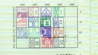 On the reverse side, stamps show the card remained in use to the final quarter of 1989, when protests precipitated East Germany's collapse.