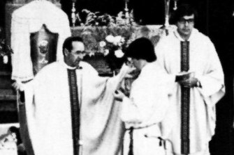 Bishop Ronald Mulkearns officiates at a mass in 1980.