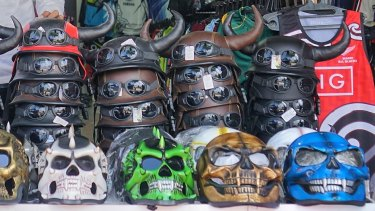A selection of motorcycle helmets for sale in Kuta.