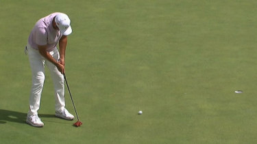 Jason Day birdies the 16th hole to move into a share of the lead during the second round of the Masters.
