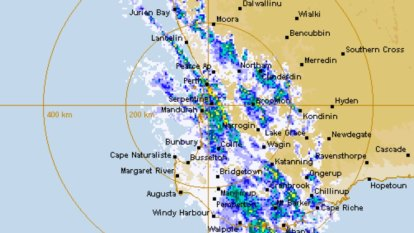 Downpours ring in first day of spring in Perth and South West
