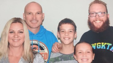 Scott Blanchard in the blue top with his three kids and wife Justine.