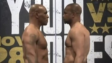 Mike Tyson and Roy Jones Jr at the weigh-in for their fight.