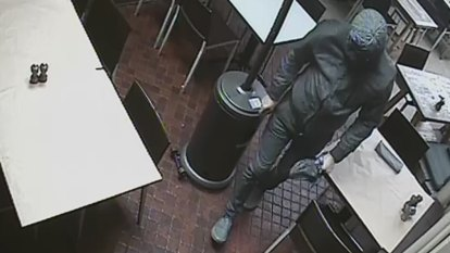 Black-clad man at Surry Hills eatery before arson and stabbing, CCTV shows