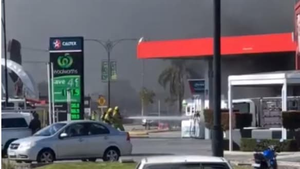 Emergency services fight to contain Perth petrol station fire