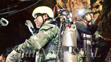 Thai Navy SEALs work to drain water out of the cave as fast as possible.