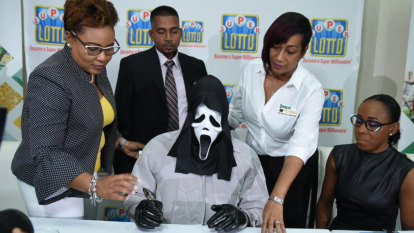 Lottery winner shows up in Scream mask to claim million-dollar prize