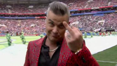 A bit rude: Robbie Williams gives the camera the finger at the end of his performance.