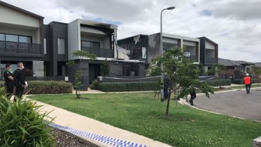 Two people have died in a suspicious fire in Point Cook.