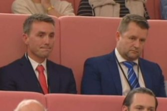 Bill McNee (right) in the federal parliament at Pauline Hanson's maiden speech in 2017, with One Nation adviser James Ashby (left).