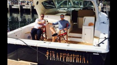 """Former McGrath Real Estate agent Adrian Bo, right, on his boat, """"Inappropriate"""" with his brother Marcello."""