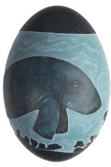 Carved emu egg by Esther Kirby, featuring a dugong.