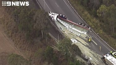The truck rolled and blocked the ramp which takes traffic from the M1 onto the Gateway Motorway.