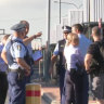 Man wielding '30-centimetre' knife shot by police at Campbelltown station