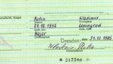 "The card is signed ""Wladimir Putin"", using German spelling."