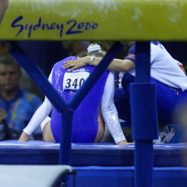 Great Britain's Annika Reeder injures her ankle after falling on the incorrectly set vault.