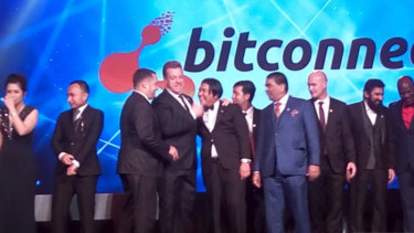 Bitcoin entrepreneur John Bigatton (fourth from left) at a BitConnect conference.