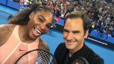 Picture perfect: Roger Federer snaps a selfie with Serena Williams at the Hopman Cup in Perth.