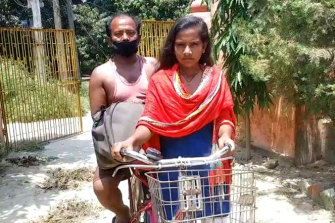 Jyoti Kumari, 15, cycled 1100 kilometres from New Delhi to her family's village, transporting her father, Mohan Paswan, a migrant labourer, on the back.