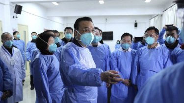 Chinese Premier Li Keqiang visited the city of Wuhan on Monday to meet with health officials and examine the response to the outbreak of a coronavirus that has killed 80 people.