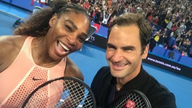 Roger Federer snaps a selfie with Serena Williams at the Hopman Cup in Perth earlier this year.