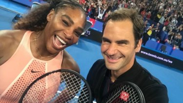 Great shot: Roger Federer snaps a selfie with Serena Williams at the Hopman Cup in Perth.