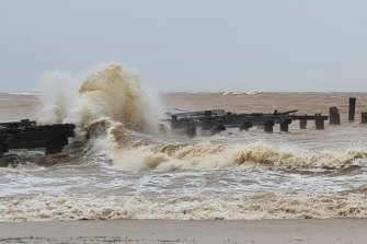 The sea swallows the historic prawning jetty at Carnarvon.