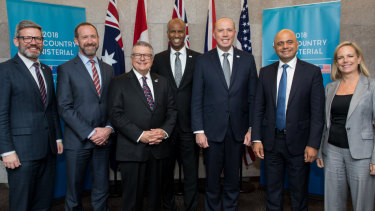Out and proud ... Peter Dutton, third from right, with fellow ministers representing the Five Eyes intelligence allies at a meeting on the Gold Coast.
