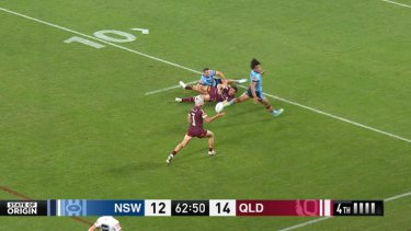 Kalyn Ponga bats the ball into the air, which Blues coach Brad Fittler says went forward. Queensland scored their final try on the next play.
