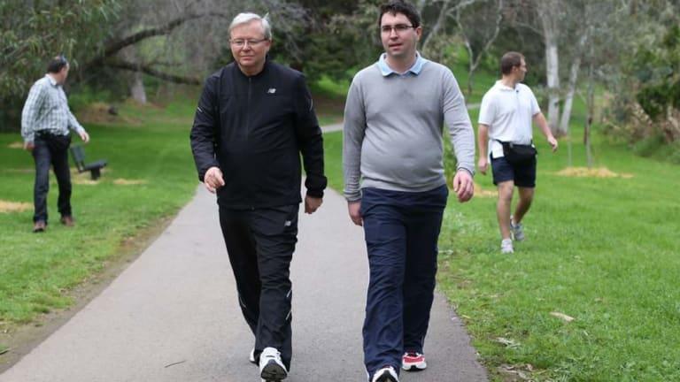 Prime Minister Kevin Rudd walks with adviser Patrick Gorman in 2013.