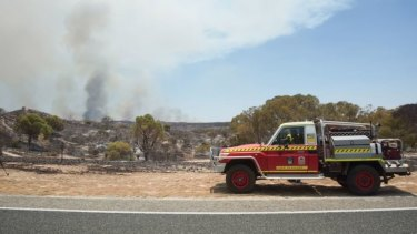 Firies still work to contain a fire burning out of control in Yanchep.