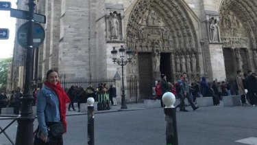 Mary Dullard out the front of the Notre-Dame in Paris just hours before fire gutted the historic cathedral.