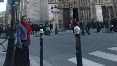 Mary Dullard out the front of the Notre Dame in Paris, just hours before fire gutted the historic cathedral.