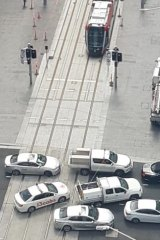 Vehicles block the light rail line at an intersection in Sydney's CBD.