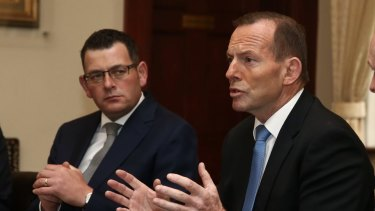 Former prime minister Tony Abbott, right, has attacked Victorian Premier Daniel Andrews for his harsh pandemic lockdown.