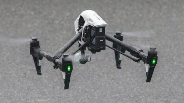 Queensland Police operate a drone at the scene of a fatal house fire at 5 Hilliup Street in Westlake on June 16, 2015 in Brisbane, Australia.