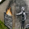 Banksy mural on garage in Wales sells for six-figure sum