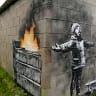 Banksy mural on garage in Wales sells for six-figure sum