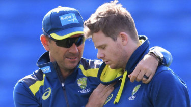 Australia coach Justin Langer, centre left, and Steve Smith, center right, during a nets session at Headingley, Leeds, England, Tuesday Aug. 20, 2019. England and Australia will begin the 3rd Ashes Test cricket match on Aug. 22. (Mike Egerton/PA via AP)