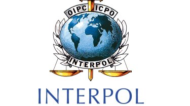 INTERPOL manages one of the largest security databases in the world and cooperates with national police departments to solve crimes and apprehend wanted suspects.