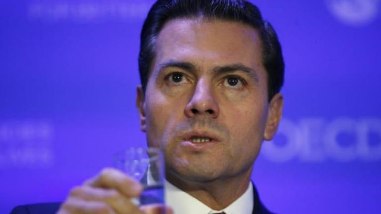 'False and defamatory:' Mexican President Enrique Pena Nieto.
